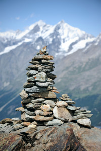 Stone cairn and mountain